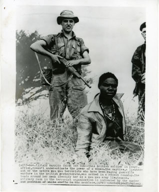 NEWS PHOTO: FEMALE MAU MAU TERRORIST DETAINED (1954)