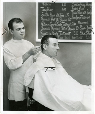 NEWS PHOTO: BARBER AND CLIENT (1955)