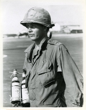 AP NEWS PHOTO: SOLDIER CARRIES NUOC-MAM (FISH SAUCE)
