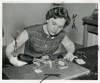 NEWS PHOTO: SCIENCE TEACHER ASSEMBLES GEIGER COUNTER 1957